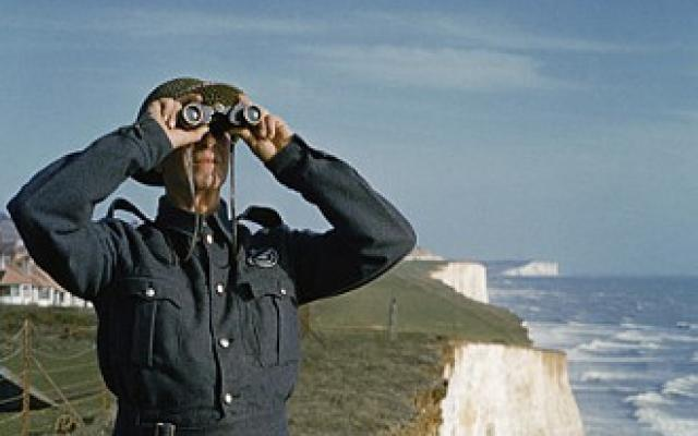 Two men of the Royal Observer Corps on a cliff top near Dover, 1943.